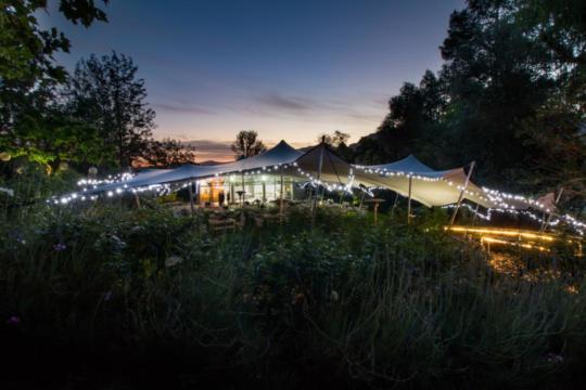 Stretch-tent-lighting-by-night